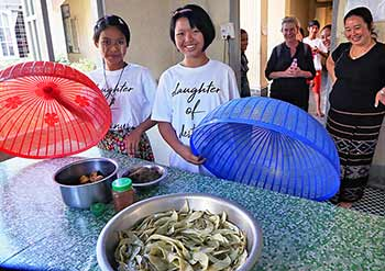 Students engage in activities like gardening, sewing, and handicrafts.
